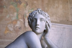 Medieval statue. Face of young Beautiful Woman Sculpture. Marble woman face. Pisa Italy
