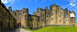Medieval stone castle panoramic landscape. Castle in England. Medieval castle panorama. Castle landmark