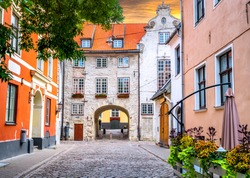 Medieval street in old Riga, Latvia, Europe. In old Riga tourists can find unique medieval architectural ensembles and ancient buildings