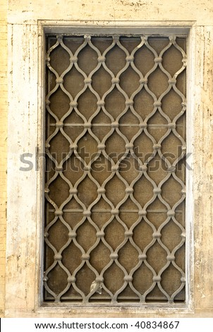 Medieval style window on stucco wall - Rome, Italy #40834867