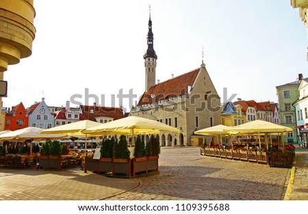 Medieval Town Hall (Tallinna raekoda) with thin high tower and Town Hall Square of Tallinn, the heart and touristic centre of Estonia' capital, in a early summer morning. Popular tourist destination.  #1109395688