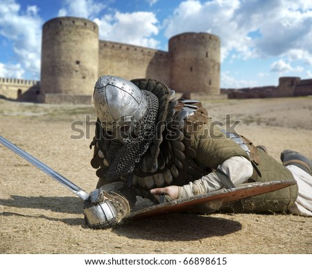 Medieval warrior defeated lying inside the fortress festival Belgorod Ukraine