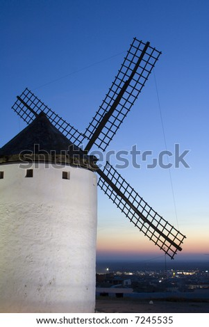 Medieval windmill dating from the 16th century overlooking the town of Campo de Criptana in Ciudad Real province, Castilla La Mancha, central Spain.