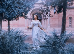 medieval woman fairytale princess white vintage dress open bare shoulders running away from old castle silk clothes waving fly fluttering in wind motion. elf girl crown tiara diadem summer nature tree