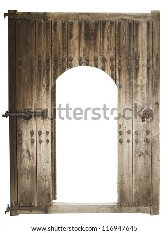 Medieval wooden door with metal hinges and studs