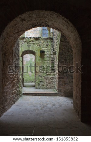 medieval yard entrance with arch