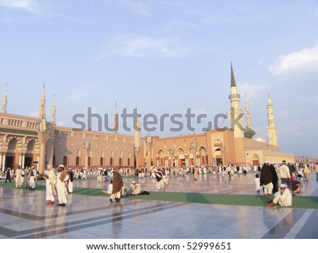 MEDINA, KINGDOM OF SAUDI ARABIA (KSA) - JAN 10 : Pilgrims walk outside Masjid Nabawi after noon prayer Jan 10, 2008 in Medina, KSA. Underneath the green dome where Prophet Muhammad is laid to rest.
