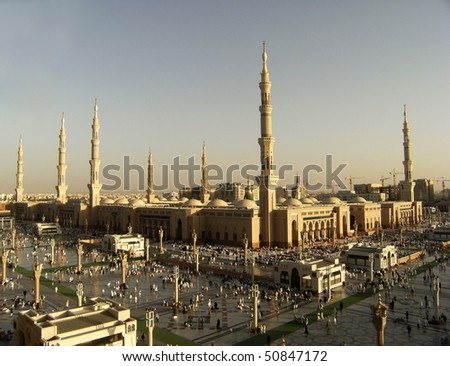 MEDINA, KINGDOM OF SAUDI ARABIA (KSA) - JANUARY 11 : Muslims gather for evening prayer at Nabawi Mosque on January 11, 2008 in Medina, KSA. Nabawi Mosque is the second holiest mosque in Islam.