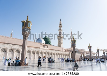 MEDINA KINGDOM OF SAUDI ARABIA SEP 22 Pilgrims relax outside Masjid Nabawi after morning prayer Sep 22 2013 in Medina KSA Underneath the green dome where Prophet Muhammad is laid to rest