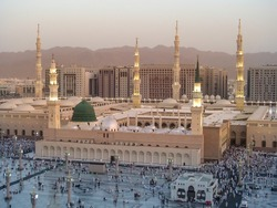 Medina Mosque, Saudi Arabia. Muslims from different countries worship in the courtyard of the Prophet's mosque. The Prophet Mosque is the second sacred mosque in the world.