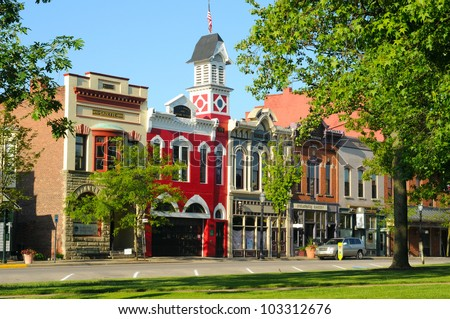 MEDINA, OH - MAY 19: East Washington Street in Medina, Ohio, on May 19, 2012, features a historic town hall and firehouse (bright red building) more than 130 years old.