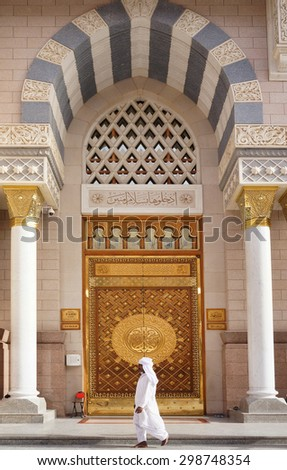 MEDINA,SAUDI ARABIA -CIRCA MAY 2015 : unidentified man walking in front of the King Fahd Door of Masjid Nabawi on May, 2015 in Medina, Saudi Arabia. Nabawi Mosque is the second holiest mosque in Islam