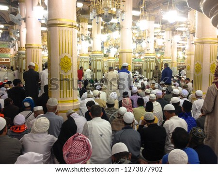 MEDINA, SAUDI ARABIA - MARCH 3 2018: Inside Al-Masjid An-Nabawi or Prophet Muhammed Mosque in Medina and here is Prophet Muhammad is laid to rest. The beautiful mosque is always full of prayers #1273877902