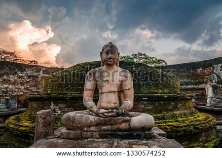 Meditating buddha statue in ancient city of Polonnaruwa, North Central Province, Sri Lanka