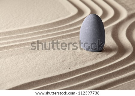 meditation and concentration for spiritual balance concept of Japanese zen garden sand and stone patterns background