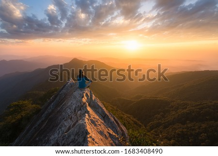 Meditation in great serenity at the top of a mountain rock in Taichung in Taiwan in front of the sun at sunset for great well being and wellness and energy Photo stock ©