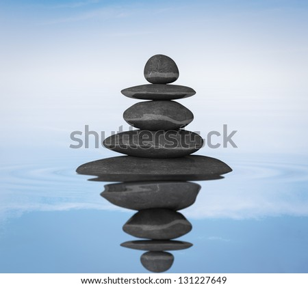 Meditation relaxation balance concept - Zen stones in water with reflection
