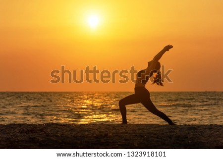 Meditation yoga spirit lifestyle mind woman peace vitality, silhouette outdoors on the Sea sunrise, relax vital abstract. Healthy Concept