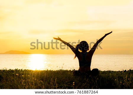 Meditation yoga spirit lifestyle mind woman peace vitality, silhouette outdoors  on the Sea sunrise, relax vital abstract.  Healthy Concept.