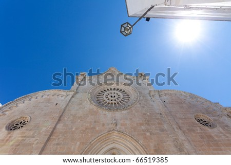 mediterian scenic witch sun, blue sky  and church
