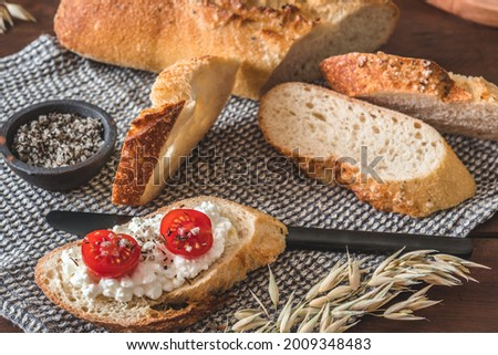Mediterranean baguette with herbes and sel de mer, one slice with cream cheese and tomatoes Stock fotó ©
