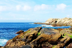 MEDITERRANEAN COAST BEACH IN MOROCCO, ROCKY COASTAL PROFILE