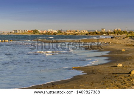 Mediterranean coast with beach and cityscape in the background #1409827388