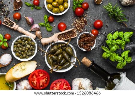 Mediterranean diet background. Cooking ingredients on dark slate. #1526086466
