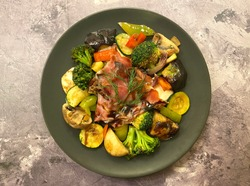 Mediterranean grilled vegetable platter, also known as Piatto misto di Verdure, with raw ham, zucchini, tomatoes, broccoli, onions, mushrooms, bell pepper, herbs and balsamic vinaigrette.