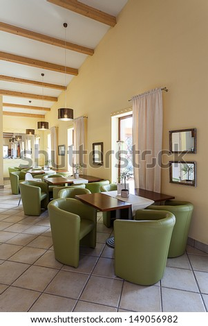 Mediterranean interior - a waiting room with tables and armchairs