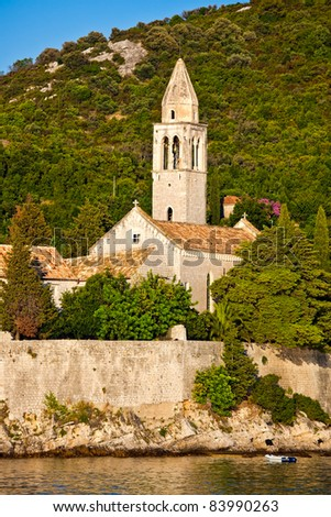 Mediterranean landscape at sunset. Island Lopud near Dubrovnik, Croatia. Old monastery with bell tower