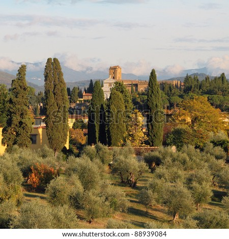 mediterranean landscape at sunset light, view of San Miniato al Monte church in Florence, Tuscany, Italy, Europe