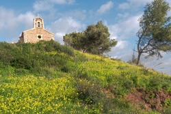 mediterranean little chapel over a hill in the countryside
