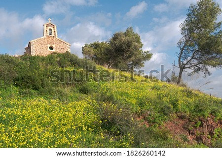 Photo of  mediterranean little chapel over a hill in the countryside