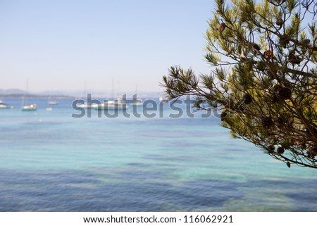 Mediterranean shores with creeks on blue transparent water, and small boat near Bandol , in France