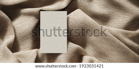 Mediterranean style mockup for product presentation. Top view of paper platform on beige fabric cloth. Clipping path of each element included. 3d rendering illustration.