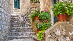 Mediterranean summer cityscape - view of a medieval street with stairs in the Old Town of Dubrovnik on the Adriatic Sea coast of Croatia
