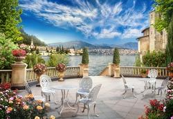 Mediterranean terrace with delicate tables. Digital mural
