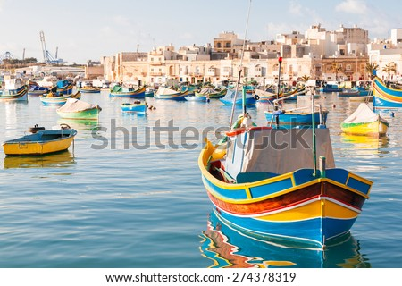 Mediterranean traditional colorful boats luzzu. Fisherman village in the south east of Malta. Early winter morning in Marsaxlokk, Malta. Stock fotó ©