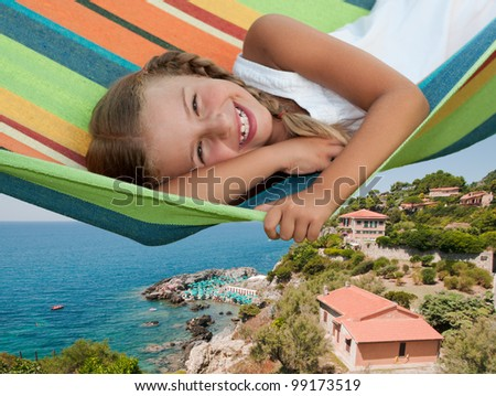 Mediterranean vacation - lovely girl in colorful hammock, Tolmezzo, Tuscany, Italy - stock photo