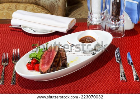 Medium Grilled bbq steaks and savory tomato sauce