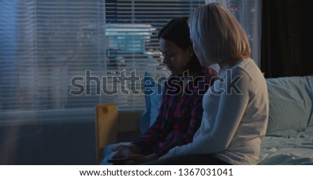 Medium long shot of mother and daughter having a conversation #1367031041