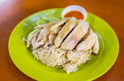 Medium portion of Singapore style Hainanese Chicken Rice served on plastic plate in Maxwell Food Centre