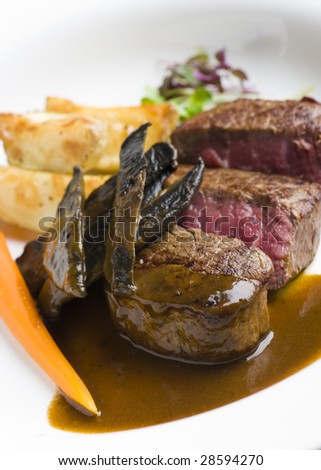 medium rare beef fillet on white plate