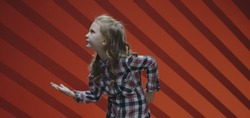 Medium shot of a child actress acting a scene in a musical