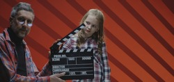 Medium shot of a child actress acting ending scene of film during film shooting