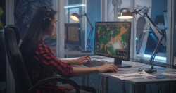 Medium shot of a young woman beta testing video game