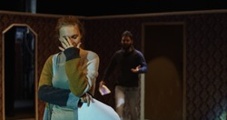 Medium shot of actors and actresses rehearsing a scene in a theater