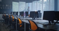 Medium shot of an empty modern workplace with workstations