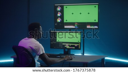 Medium shot of video editor working at his workstation Сток-фото ©